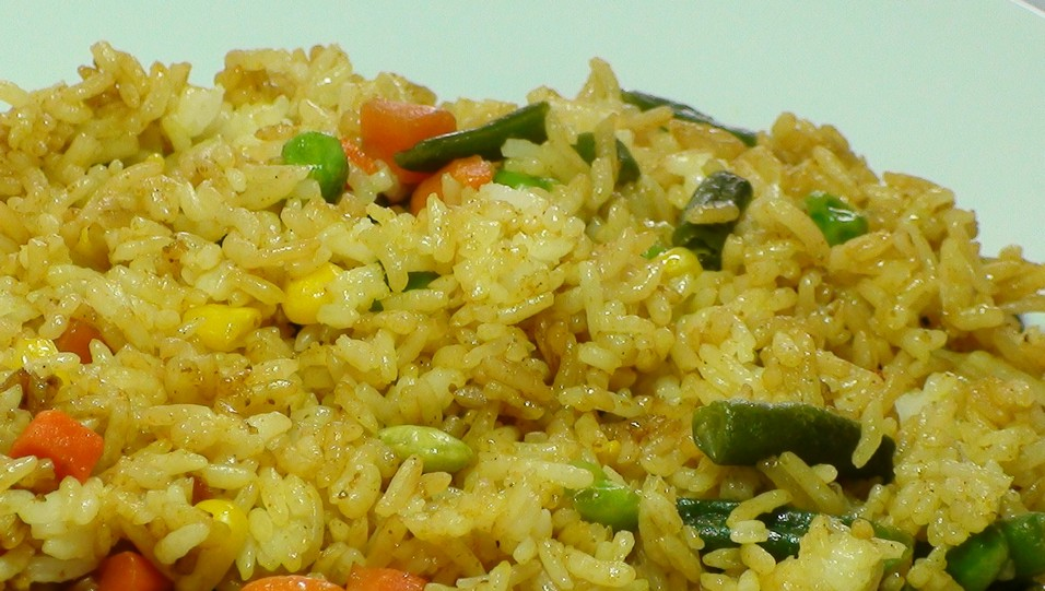 Vegetable Fried Yellow Rice And frozen vegetables,